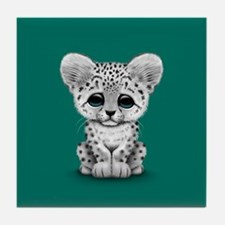Cute Baby Snow Leopard Cub on Teal Blue Tile Coast