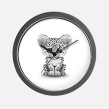 Cute Baby Snow Leopard Cub on White Wall Clock