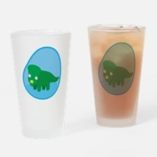 Little green dinosaur in the womb Drinking Glass
