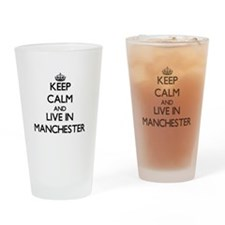 Keep Calm and live in Manchester Drinking Glass
