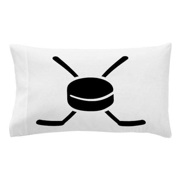 Crossed hockey sticks with puck