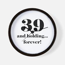 39 & Holding Wall Clock