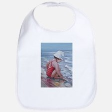 Little girl with white hat at the beach Bib