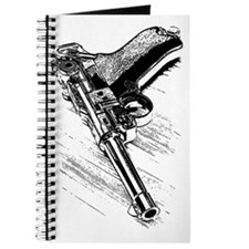 A pistol on the wooden table Journal