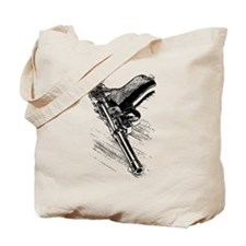 A pistol on the wooden table Tote Bag