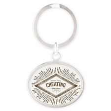 Never Stop Creating Oval Keychain