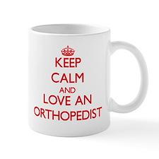 Keep Calm and Love an Orthopedist Mugs