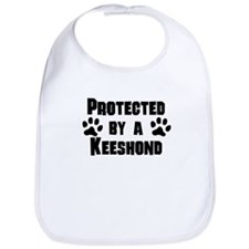 Protected By A Keeshond Bib