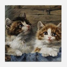 Two young cats in a basket with a blu Tile Coaster