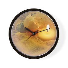 helle kerze im sand Wall Clock