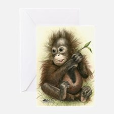 Orangutan Baby With Leaves Greeting Cards