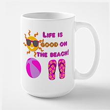 Life is good on the beach! Mugs