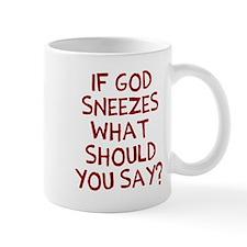 God Sneezes Mugs