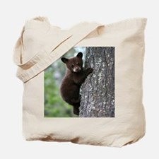 Bear Cub Climbing a Tree Tote Bag
