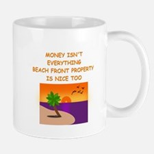 money isnt everything Mugs