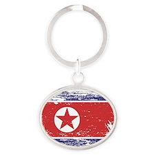 Grunge North Korea Flag Oval Keychain