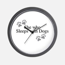 she who sleeps with dogs Wall Clock