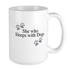 she who sleeps with dogs Mugs