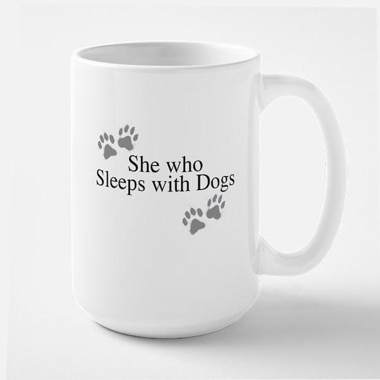 she who sleeps with dogs Mugs