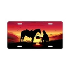 Cowboy And Horse At Sunset Aluminum License Plate
