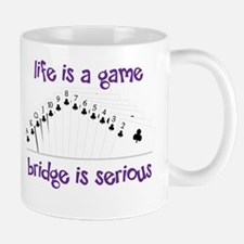Life Is A Game bridge is serious Mugs