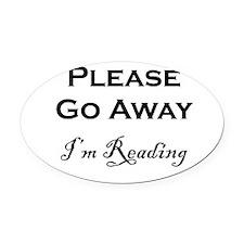Please Go Away Im Reading Oval Car Magnet