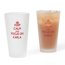 Keep Calm and focus on Karla Drinking Glass