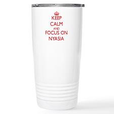 Keep Calm and focus on Nyasia Travel Mug