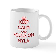 Keep Calm and focus on Nyla Mugs