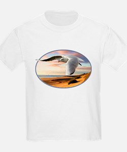 gull on the wing over beach T-Shirt