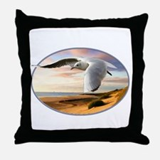gull on the wing over beach Throw Pillow