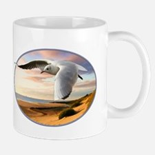 gull on the wing over beach Mugs