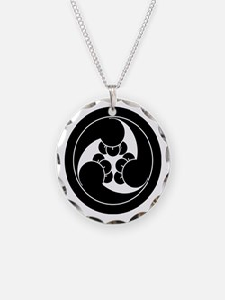 Three clockwise clove swirls Necklace