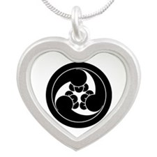 Three clockwise clove swirls Silver Heart Necklace