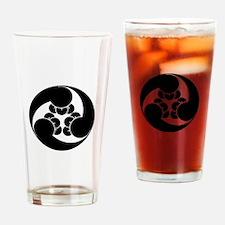 Three clockwise clove swirls Drinking Glass