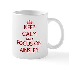 Keep Calm and focus on Ainsley Mugs