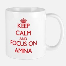 Keep Calm and focus on Amina Mugs