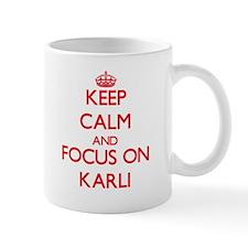 Keep Calm and focus on Karli Mugs
