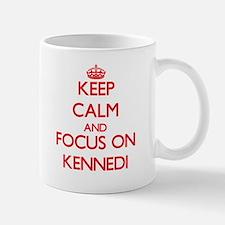 Keep Calm and focus on Kennedi Mugs