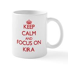 Keep Calm and focus on Kira Mugs