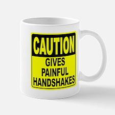 Gives Painful Handshakes Mug
