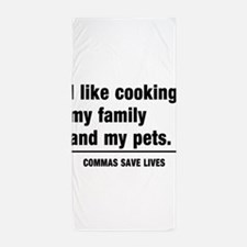 Commas save lives Beach Towel