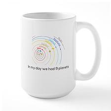 9 planets Mugs