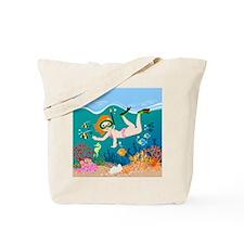 Girl swimming in tropical sea Tote Bag