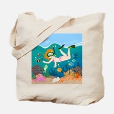Girl swimming in tropical sea Tote Bag