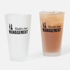 Under New Management Drinking Glass