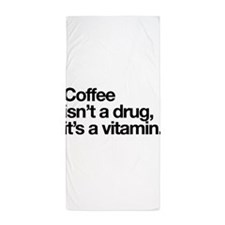 Coffee isn't a drug it's a vitamin Beach Towel