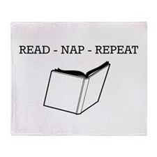 Read, nap, repeat Throw Blanket