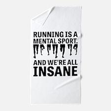 Running is a mental sport Beach Towel