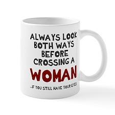Crossing a woman Mug